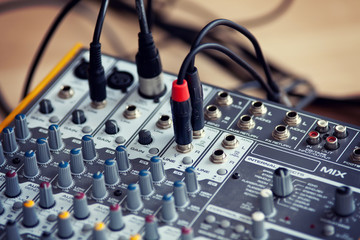 Audio studio sound mixing equalizer equipment board with wires