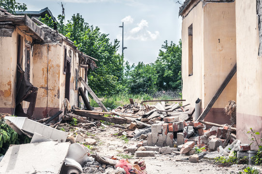 Aftermath catastrophe after hurricane or war disaster damaged and ruined house collapsed property with moody and dark sky