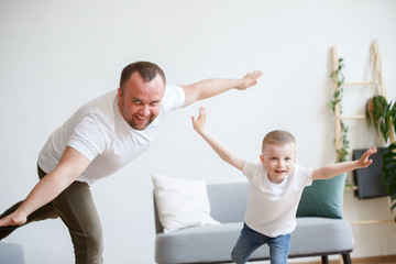 Image of young father with son playing in plane