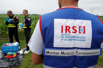An employee of French Radioprotection and Nuclear Safety Institute takes part in the training of French firemen during a nuclear accident drill near France's oldest nuclear power station of Fessenheim