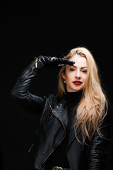 Photo of young blonde in leather jacket makes salute