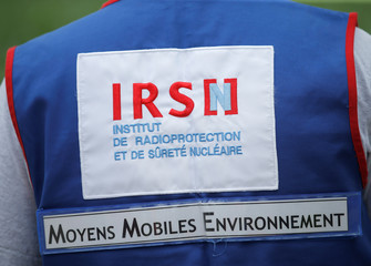 An employee of French Radioprotection and Nuclear Safety Institute (IRSN) takes part in a nuclear accident drill near France's oldest nuclear power station of Fessenheim