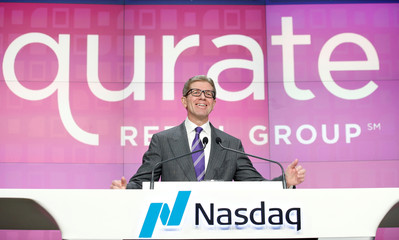 Mike George, President and CEO, Qurate Retail, Inc., attends the opening bell ceremony for his company at the Nasdaq Market in New York