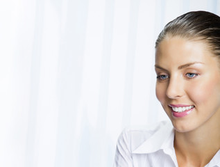Happy smiling young businesswoman
