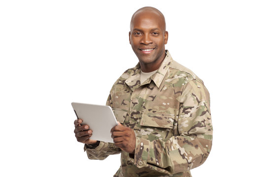 African American Soldier with Computer in Studio Smiling