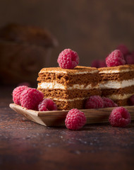 Layered honey cake with cream and raspberries.