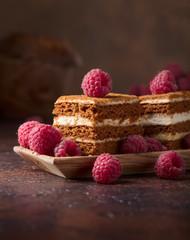 Layered honey cake with cream and raspberries.