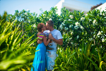 Guy and girl kissing in the Park in summer
