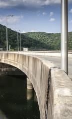 Details of a curved concrete dam on the lake Tarnita, transilvania, Romania
