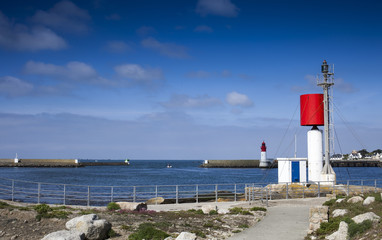 Small lighthouses at the main entrance of the big harbor of Guilvinec village, Brittany, France, early in the morning