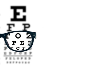 Eyeglasses with blurred optician visual text chart on a white background. Blank or empty space for your message