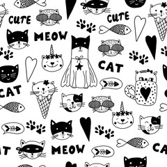 Seamless pattern with doodle cats.