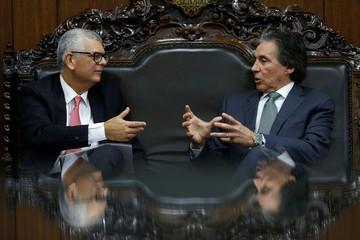 Monteiro, President of Brazil's state-run oil company Petroleo Brasileiro SA (Petrobras), speaks with President of the Brazilian Federal Senate Oliveira during a meeting in Brasilia
