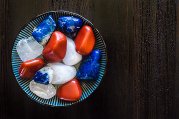 Bowl of Red, White and Blue Stones with Space for Copy