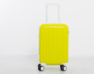 Yellow suitcase isolated on white background .Summer holidays. Travel valise or bag. Mock up. Copy space. Template. Blank.