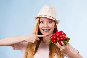 Happy woman holding radish