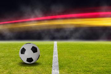 Fußball im Stadion mit Deutschland Flagge aus Licht