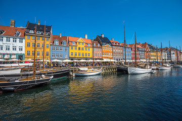 Nyhavn district is one of the most famous landmarks in Copenhagen, Denmark