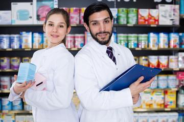 Portrait of glad expert and female pharmacist