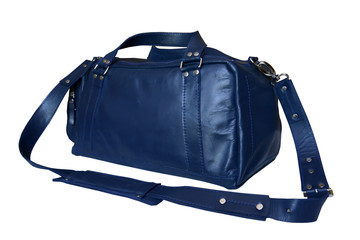 Leather traveling bag of blue color with a removable shoulder strap, it is isolated on a white background