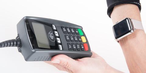 Customer paying bill by watch phone
