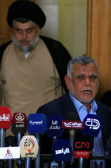 Leader of the Conquest Coalition and the Iran-backed Shi'ite militia Badr Organisation Hadi al-Amiri speaks during a news conference with Iraqi Shi'ite cleric Moqtada al-Sadr, in Najaf