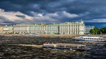 Winter Palace. The State Hermitage Museum on the gloomy sky background. St.Petersburg, Russia