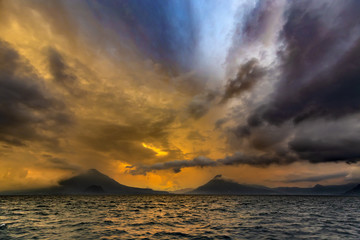 Guatemala. Panoramic view of Lake Atitlan (Lago de Atitlan). There are volcanoes (from left to right): Atitlan, Toliman and San Pedro