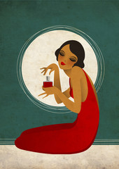 Woman in red dress with perfume bottle