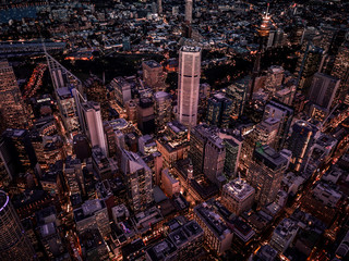 Tall buildings in the city and in the evening from above