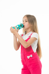 Only clean and fresh water. Girl with water bottle drinking, isolated on white background. Kid girl with long hair drinks. Fresh drink concept. Girl cares about health and refreshing