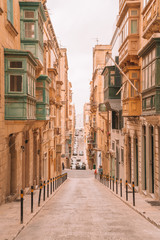 Valletta, Malta - The traditional houses, narrow streets and walls of Valletta, the capital city of Malta on an early summer morning before sunrise