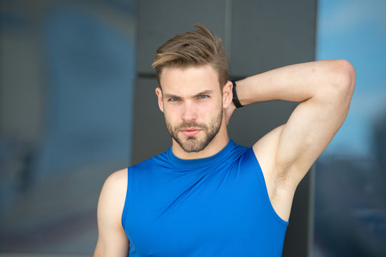 Man confident in his antiperspirant. Sportsman after training pleased with antiperspirant. Guy checks dry armpit satisfied with healthy skin. Prevent, reduce perspiration. No sweat - deodorant works