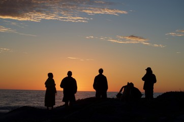Group of friends watching the sunset