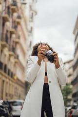Female Photographer Holding an Old Analog Camera