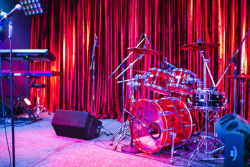 Artist Stage With Drums and Keyboards Sets Along With Microphones Stands and Stage Monitors