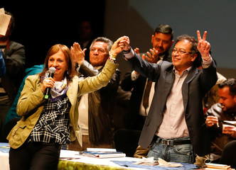 Colombian presidential candidate Gustavo Petro and vice presidential candidate Angela Robledo gesture while participating in a meeting, ahead of the second round of presidential voting, in Bogota