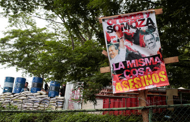 """A banner that reads """"Ortega and Somoza the same thing. Assassins"""" is seen at the National Autonomous University of Nicaragua during a protest against Nicaragua's President Daniel Ortega's government in Managua"""