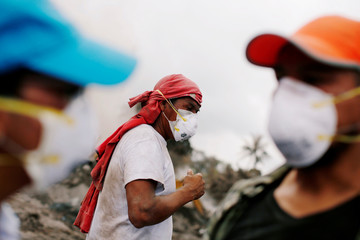 A resident reacts during a search at an area affected by the eruption of the Fuego volcano at San Miguel Los Lotes