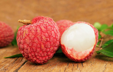 close up lychee on wood