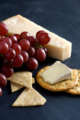 Red Grapes, Cheese and Crackers on Black