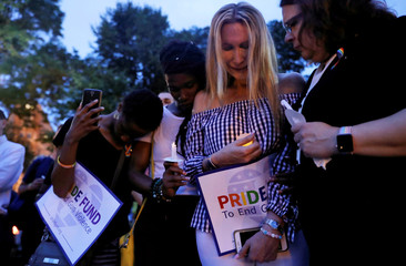 People take part in a candlelight vigil to commemorate the two year anniversary of the Pulse nightclub shooting in Orlando at Dupont Circle in Washington, DC