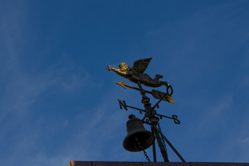 Weather vane draped in cobwebs atop a mausoleum at the Recoleta Cemetery in Buenos Aires, Argentina.