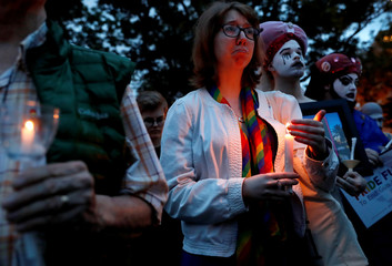 People take part in a candlelight vigil to commemorate the two year anniversary of the Pulse nightclub shooting in Orlando at Dupont Circle in Washington