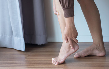 Woman having ankle pain,Female feeling exhausted and painful