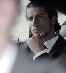 businessman sitting in his car.