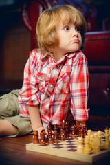 child plays chess