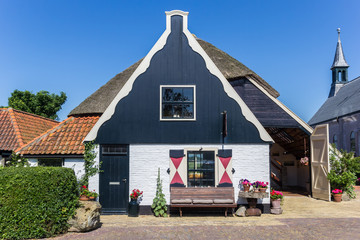 Traditional dutch house in Oudeschild, The Netherlands Wall mural