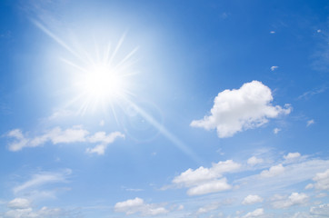 Cloudy and blue sky with sun ray effect abstract background
