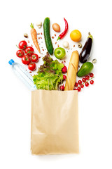 Picture of paper bag with vegetables, juice, orange, loaf